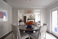 A sculptural fixture makes a statement in this dining room designed by Susan Smith Designs. #luxeDallas