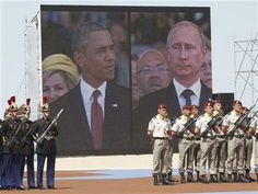 A large screen shows a picture of Russian President Vladimir Putin, right, and U.S. President Barack Obama during the commemoration of the 70th anniversary of the D-Day in Ouistreham, western France, Friday, June 6, 2014. (AP Photo/Christophe Ena, Pool) ▼6Jun2014AP|AP PHOTOS: D-Day remembrance in Normandy http://bigstory.ap.org/article/ap-photos-d-day-remembrance-normandy #D_Day