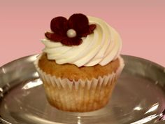 Winning Recipe Raspberry Cupcakes with Champagne Buttercream Frosting recipe from Cupcake Wars via Food Network