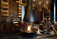 """The Chedi Hotel, Andermatt.  Beautiful slatted """"walls"""" section off banquette areas like transparent screens."""