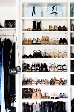 Master bedroom closet features floor to ceiling built ins boasting shelves  for shoes and boots beside a shelf reserved for displaying handbags over clothes rail.
