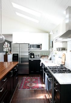 Beautiful black white & butcher block kitchen by @housetweaking