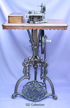 """The Britannia Sewing Machine Co. marketed this machine as the """"No.1"""" in the early 1870s. The combination features a Wheeler & Wilson style head, mounted on a delightfully ornate tripod treadle of the company's own registered design. Today this model can be considered very rare"""
