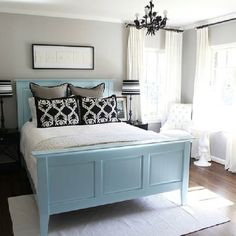 Cool Greys And Blues, Three Layers Of Cushy Pillows, Soft Rug Half Under The
