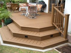 Trex Accents deck with our singnature concrete curb to prevent weed whacker damage to fascia.