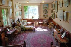 giverny sitting room - stained wainscoting on bottom. wood rails around room for hanging art.