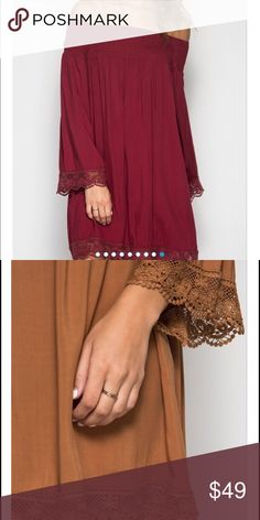 """NOW AVAILABLE!  Wine Off Shoulder Dress Wine colored long sleeve off shoulder shift dress. Has elastic smocking and crochet trim hemline. Smocking is 70% cotton/30% polyester and crochet trim is 100% cotton woven. This dress is beautiful! The busts measure (S) 18.5"""", (M) 20"""", (L) 21.5"""". I wear a 12/14 usually and the large fit me perfectly! It is a loose fit, I recommend sizing down one size from your typical size! All lengths are 31"""". mackenzi lane Dresses"""