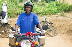 Bizimana Donath (38) delivers milk to a dairy collection center in Rwanda. After becoming part of a Heifer project, Donath was able to earn enough income to purchase a motorcycle that he uses to collect and deliver his neighbors' milk.   In eastern Africa, collection centers like this one increase dairy farmers' income by providing an accessible place to store milk. From the collection center, the milk can be sold to dairy processors or sent to markets that would otherwise be out of reach.