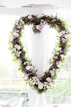 Modern romantic wreath. maybe not a heart, but I like the lay of the flowers