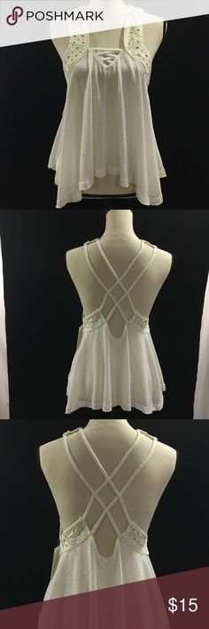 BEAUTIFULOff White Crochet Tank Top Cream colored / Off White tank top with crochet shoulders and criss cross back.  Loose fitting and flowy for spring and summer and an AMAZING flattering fit for all body types.  A gorgeous piece for the Southern Spring and the Summer in every corner of the USA. Tops Tank Tops