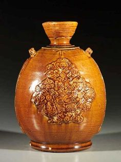 Pottery flask with applied decoration -China, Liao dynasty, 10th century Height: 9 1/2 inches, 24 cm