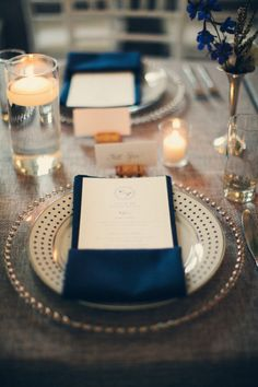 Love this pin? Follow us at www.pinterest.com/nricouple for more! Navy blue table accents with cork place card holders