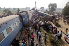 A train in northern India has derailed, killing at least 100 people and injuring dozens more, police officials have said.