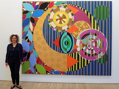 Beatriz Milhazes, with her painting <em>Marcujola</em> (2015) at James Cohan gallery. Photo: Sarah Cascone.