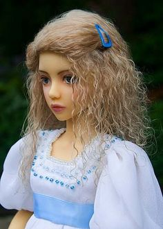 dolls- actually is a tutorial for of the Tibetan / goat lambskin wigs for the dolls but the dolls are beautiful