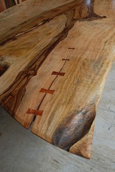 Butterfly joints on gorgeous live-edge table - Beautiful visible repairs