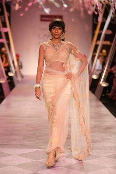 Tarun Tahiliani Lakme Fashion Week Summer Resort 2014 peach and cream Indian bridal sari. See all Fashion Week photos here: http://www.indianweddingsite.com/indian-wedding-photo-gallery/fashion-lakme-fashion-week-summer-resort-2014/