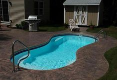 Looking for inground pool coping ideas and cost? Check out pictures and pricing for the four most common types of inground pool coping. Small Outdoor Patios, Backyard Ideas For Small Yards, Small Backyard Patio, Sloped Backyard, Modern Backyard, Diy Patio, Pool Coping, Swimming Pool Landscaping, Swimming Pool Designs