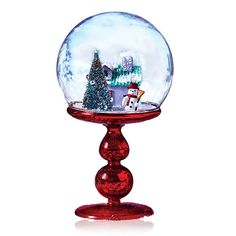 """Step up your holiday decor! This charming, sweet scene will compliment your holiday decor perfectly!FEATURES•Red base/pedestal•Clear glass globe•Tree with snow on branch tips and ornaments•Snowman with a red hat and scarf holding a broom•House with green and red roof and snow•Globe does not have loose particles to create a """"snowing"""" effect, so it should not be shaken like a snow globe•4 3/4"""" diam. x 8 1/4"""" HMATERIAL..."""