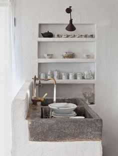 Photos Mediterranean Rustic Kitchen: A stone sink and brass faucet in the kitchen of a Spanish artist's cottage.Mediterranean Rustic Kitchen: A stone sink and brass faucet in the kitchen of a Spanish artist's cottage. Wabi Sabi, Kitchen Interior, Kitchen Decor, Kitchen Sinks, Kitchen Shelves, Kitchen Ideas, Kitchen Photos, Stone Kitchen Sink, Kitchen Cutlery