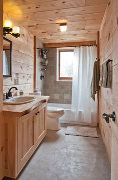 The First Straw: An Energy-Efficient Dream Home in Kerhonkson, NY. Straw-bale construction in a timber-frame home. Environmentally friendly white pine was used throughout the house.The bathroom tiles are cut limestone with visible embedded fossils.   (Photo: DEBORAH DEGRAFFENREID)   #strawbale #timberframe