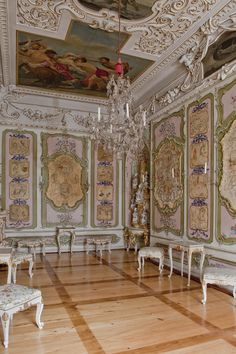 """Japanese Room, Eggenberg Palace,Graz, Austria.  The second room to incorporate chinoiseries in its design is a sort of """"picture cabinet"""". In this room, Chinese silk screens were cut to create tiny genre works and framed like miniatures. The decoration on the walls gives the illusion that the miniatures are hanging from blue silk ribbons."""