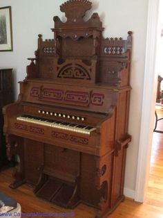 """Antique walnut cased pedal organ (original works replaced with an electric motor); measures 46"""" wide. bids close Wed, 31 Aug from 11am ET."""