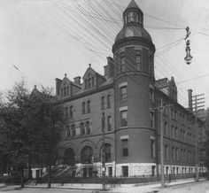 Presentation Academy, Louisville, Kentucky, 1923. :: Herald-Post CollectionPresentation Academy, Fourth & Breckinridge Streets, Louisville, Kentucky. Massive, three-story brick building with large dormers and a round corner tower with a dome and a pillared cone atop. Most of the windows are domed; the windows on the upper floors are narrow, while the first floor windows are wide and are topped with arches wide enough to touch from one window to the next.