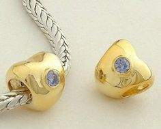 """Heart with a Blue Stone"" 18k Gold on 925 Sterling Silver Charm Bead for Pandora, Biagi, Chamilia, Troll and More Bracelets general gifts. $12.99. Suitable for 3mm Cable Pandora and other European Charm Bracelets. Quantity: 1pc. 18K gold plated 925 Sterling Silver. Hole Size: 4.5mm. Color: Silver with 18K gold. Save 78%!"