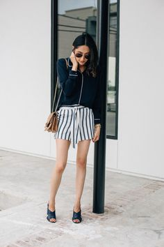 745a8dfd Houston blogger Lilly Beltran wears striped shorts with a long sleeves top  for a chic spring