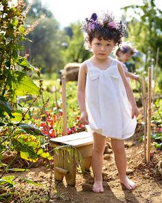Adorbs. From Benneton. Love the flower crown and the smock dress.