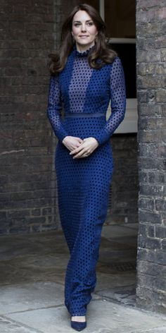 The Duchess of Cambridge stuns in a blue dress by Indian designer Saloni for a reception before her milestone trip to India and Bhutan with Prince William.