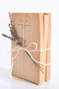 vintage books bundled with lavender - I probably wouldn't use yarn like this. I'd use twine or an old ribbon.