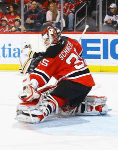 NEWARK, NJ - JANUARY 02: Cory Schneider #35 of the New Jersey Devils makes a glove save against the Boston Bruins during the game at Prudential Center on January 2, 2017 in Newark, New Jersey. (Photo by Andy Marlin/NHLI via Getty Images)