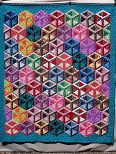 Gorgeous.  I love these illusion quilts!
