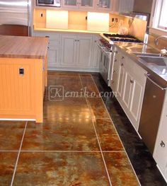 Golden Wheat w/ Green Lawn Kemiko Stain for Concrete Gallery Image Stained Concrete, Concrete Floors, Concrete Coatings, Cabana, Tile Floor, New Homes, Kitchen Cabinets, Green Lawn, Flooring