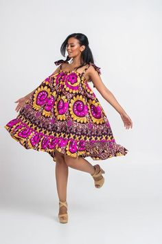 Here at Grass-fields we have an awesome range of African dress designs. Whether you're after an African print maxi or midi dress, we've got something for you. Short African Dresses, Latest African Fashion Dresses, African Print Dresses, Beautiful Ankara Styles, Trendy Ankara Styles, African Print Clothing, African Print Fashion, African Attire, African Wear