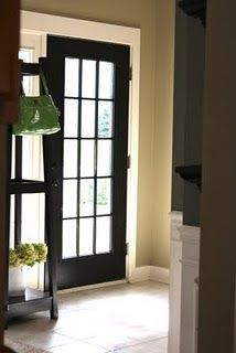 this is so cool...she took a regular door, had it cut and added glass to the middle...for about $100...