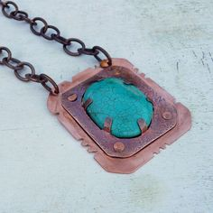 Hand Forged Copper And Turquoise Howlite Pendant Necklace Hand cut copper which I stamped, patined, polished and drilled. I added a large stabilized turquoise colored howlite cabochon, and hung on a small link copper chain that closes with a copper toggle clasp. A bold easy to wear one of a kind necklace. The necklace measures 24 inches, however if you would like it longer or shorter, just add your length request in checkout.