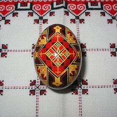"Crosses are fairly common, although most of those found on traditional pysanky are not Ukrainian (Byzantine) crosses. The crosses most commonly depicted are of the ""cross crosslet"" type, with arms of equal lengths. In ancient times the cross was a sun symbol, an abstracted representation of the solar bird."