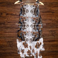 """FREE PEOPLE Dress Floral Printed Cutout Back Slip Size Small. New with tags. $88 Retail + Tax.  Sheer printed intimate slip dress with tie back.  Drop waist and flounce hem.  Rayon. Imported.   Measurements for Small: Bust: 38"""" Length: 34.5""""    ❗️ Please - no trades, PP, holds, or Modeling.    Bundle 2+ items for a 20% discount!    Stop by my closet for even more items from this brand!  ✔️ Items are priced to sell, however reasonable offers will be considered when submitted using the blue…"""