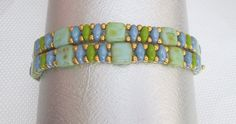 A pretty green tila wrap bracelet with superduo beads of green and gold. The color of this bracelet is truly beautiful. It is as special and unique as you are. It is a wrap bracelet which can be worn stacked with other bracelets or all by itself. It goes with that casual outfit or a pretty