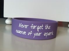"Lucy Hale tweeted this quote saying it was her new favorite quote.     The bracelet says ""Never forget the essence of your spark"" on the front and has Lucy's initials on the back.    Light purple (little lighter than the picture) phat band with white lettering."