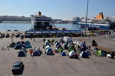 Trapped in the midday heat: Dozens of tents line the port of Piraeus, where around 5,500 m...