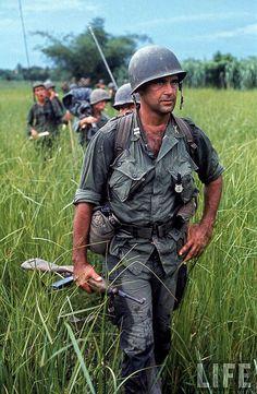 Vietnam War 1964 - U.S. Army Captain Robert Bacon leading a patrol.