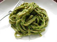 Avocado Pesto Recipe with avocado, lime, pinenuts, grated parmesan cheese, arugula, basil, extra-virgin olive oil, garlic