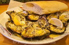 charbroiled oysters at dragos - OMG delicious!!!  http://www.travelguidenpx.com/pictures/what-to-do-new-orleans-food.html#