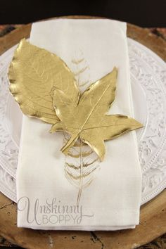 Here is a simple project with high impact results. Using leaves from my yard, polymer clay and spraypaint, I created these pretty golden leaves for my fall place settings. You could also punch a hole in them and hang them from your Christmas tree. Run leaves through a pasta machine with a rectangle of polymer clay, bake and spray with gold metallic spraypaint. Super simple! For the full tutorial, see my blog post: http://unskinnyboppy.com/2013/09/how-to-make-golden-leaves-from-clay/