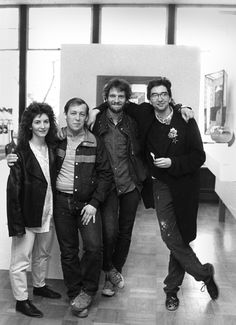 Alums Pamela Argentieri, Mike Mikula, John Carter, and David Pohl from the class of 1987 break for a photo in Reinberger Galleries.