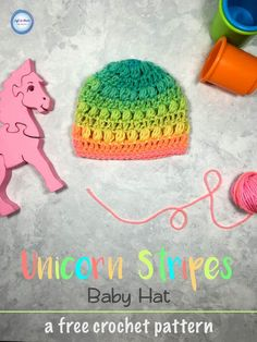 A free crochet pattern!  This rainbow hat is a fast and simple pattern perfect for a new baby.  Make it alone or with the matching Unicorn Stripes Baby Blanket as a  perfect set for gifting.  The rainbow colors would make this extra special for a rainbow baby!  Use Red Heart Super Saver Stripes or your favorite worsted weight yarn.